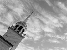 Church spire, angled. Church spire, in black-and-white, angled against a cloudy sky Royalty Free Stock Photography