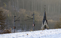 Church spire behind a overhead wiring Royalty Free Stock Image