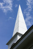Church spire. Detail of a church spire against a blue sky with wispy clouds in Alabama, USA royalty free stock images
