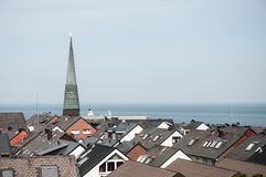 Church spire and rooftops stock images