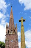 Church spire and stone cross, Weobley. Stock Photo