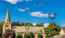 A church with a spire on a sunny day. royalty free stock photo