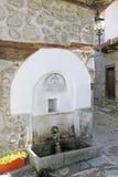 Church Spring. Water spring near the Saint Trinity church entrance in the centre of Bansko, Bulgaria Stock Photos