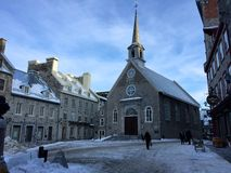 Church Square, Quebec City's Old Town, cold late winter evening. A view of Quebec City's Church Square on a cold evening in late winter. In summer this area is royalty free stock images