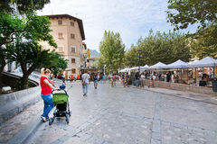Church square tourists tram. SOLLER, MALLORCA, SPAIN - OCTOBER 2, 2016: Church square with market, tourists and tram on a sunny day on October 2, 2016 in Soller Stock Photo