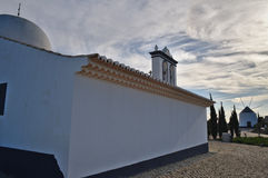 Church of St. Anthony and windmill in Portugal Stock Photos