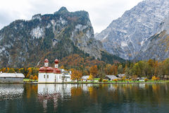 Church of St. Bartholomew on the lake Koenigssee. In autumn Royalty Free Stock Images