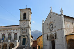 The church of St. Benedict with Town Hall, Norcia. The church of St. Benedict and Town Hall both face Piazza San Benedetto, in Norcia. Norcia, a walled town in Stock Images