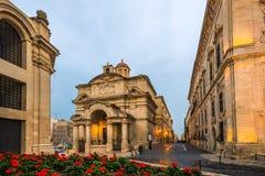 The Church of St Catherine,Valletta,Malta. Evening street view Stock Photos
