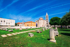 Church of st. Donat, a monumental building from the 9th century with historic roman artefacts in foreground in Zadar, Croatia Royalty Free Stock Image