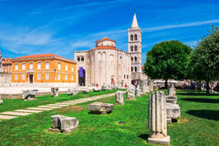 Church of st. Donat, a monumental building from the 9th century with historic roman artefacts in foreground in Zadar, Croatia Stock Photos