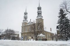 Church winter scene in Saint-Eustache. The church of St. Eustache is a Roman Catholic rite church built in 1783 which is located in Saint-Eustache in Quebec Stock Images