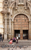 Church of St. Francis of Assisi in Lima. LIMA - SEPTEMBER 10: People feeding pigeons on the steps of the Church of St. Francis of Assisi in Lima, Peru, on Royalty Free Stock Photography