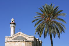 Church of St. George in Lod and minaret. Church of St. George  Lod and minaret Royalty Free Stock Image
