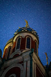The Church of St. George in the town of Medyn, Kaluga region in Russia on the background of the starry sky. stock images