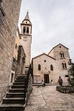 Church of St Ivan bell tower. Courtyard and stairs to the bell tower of the Church of St Ivan, Budva, old town, Montenegro royalty free stock image