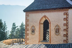 Church of St. Jacob overlooking forests and mountains in winter Royalty Free Stock Photos