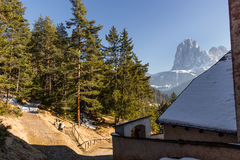 Church of St. Jacob overlooking pine forests and snow-capped pea Stock Image
