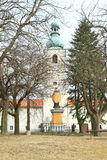 Church of St. Jan Nepomucky. Behind alley of old trees and statue of St. Jan Nepomucky in Svaty Jan nad Malsi, Czech Republic Stock Image