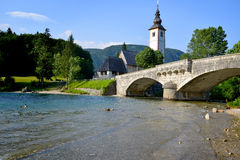 Church of St John the Baptist, Bohinj Lake, Slovenia. Church of St John the Baptist and old bridge, Bohinj Lake, Slovenia Royalty Free Stock Images