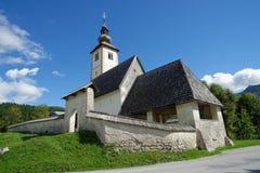 Church of St John the Baptist, Bohinj Lake, Slovenia. Wide angle view of church of St John the Baptist, Bohinj Lake, Slovenia Royalty Free Stock Images