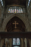 Church of St John the Baptist Cross above Rood Screen. England, Cirencester - Jan 16, 2017: Church of St John the Baptist, Medieval Early English Gothic Stock Photo