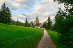 Church of St. John the Baptist in Ribchev Laz village. Bohinj Lake, Triglav national park Slovenia, Julian Alps, Europe Royalty Free Stock Images