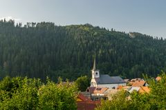 Church of st. King Stephen. In Oravsky Biely Potok at sunset royalty free stock photography