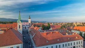 Church of St. Mark timelapse and parliament building Zagreb, Croatia. Top view from Kula Lotrscak tower before sunset stock video footage
