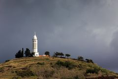 The Church of St Martin Funchal. The Church of St Martin Igreja de Sao Martinho on top of the hill with ominous clouds in Funchal, Madeira stock photo