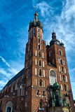 Church of St. Mary in the main Market Square on the background  dramatic sky. Basilica Mariacka. Krakow. Poland. Stock Images