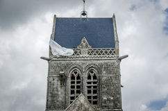 Church in St. Mere Eglise, Normandy Paratrooper hanging. On roof of the church Stock Image