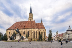 Church of St.Michael with statue of Matei Corvin in Cluj - Napoca Stock Image