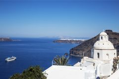 Church of St. Minas against Caldera in town Fira, Santorini island,. Greece stock images