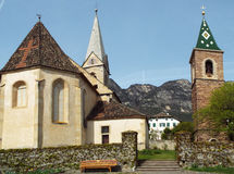 Church St. Nicholas in Caldaro. Church with two steeples in the district of St. Nicholas of Caldaro, South Tyrol, Italy 04/13/2015 Royalty Free Stock Image