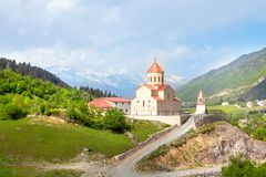 Church of St. Nicholas on the hill of mountains background in Mestia, Georgia royalty free stock photo