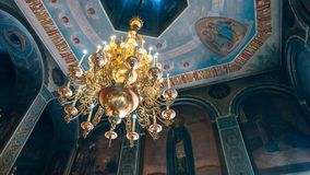 Church of St. Nicholas, large gold or bronze chandelier in the temple or cathedral, big bronze with handelier in the church, ortho. Dnipro, Ukraine - August 06 Royalty Free Stock Photos