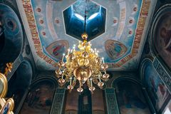 Church of St. Nicholas, large gold or bronze chandelier in the temple or cathedral Royalty Free Stock Photography