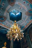 Church of St. Nicholas, large gold or bronze chandelier in the temple or cathedral Royalty Free Stock Photos