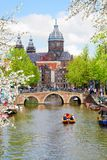 Church of St Nicholas , Amsterdam. Church of St Nicholas, old town canal, Amsterdam with spring tree, Holland stock images