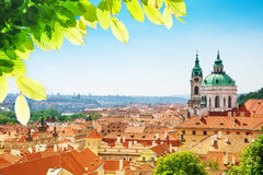 Church of St. Nicholas red tile roofs in Prague Royalty Free Stock Images
