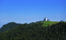 Church of St. Primoz near Jamnik with Alps, Slovenia, Europe Stock Photography