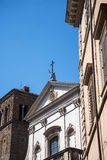 Church with a stags head over the facade in Rome Italy that has books as the main theme Stock Photo