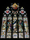 Church Stained glass 2. Large religious Stained glass arch in church Stock Photo