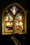 Church stained glass window featuring religious scenes. Royalty Free Stock Photography