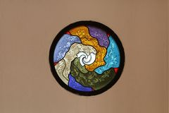 Church stained glass window, Metaphorical, circle colors glass on concrete brown wallpaper stock photography