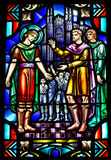 Church Stained Glass Window with Religious Scene. Religious scene is depicted in this stained glass window from an old Catholic church. Many colors are used to Stock Images
