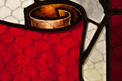 Church stained glass windows. Beautiful red scroll on a church's stained glass windows Stock Photo