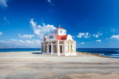 The Church standing on the coast. Crete. Greece. Royalty Free Stock Photo