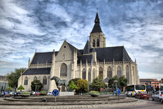Church and the statue of horse in the centre of Vilvoorde. City near Brussels, Belgium Royalty Free Stock Photography